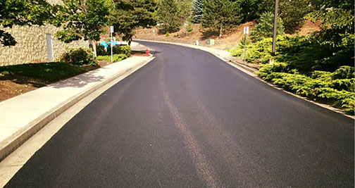 facility-upgrades-asphalt-grocery-entrance